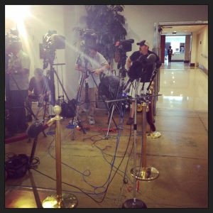 Waiting for a press conference to begin in the basement of the Capitol after a Pentagon briefing.